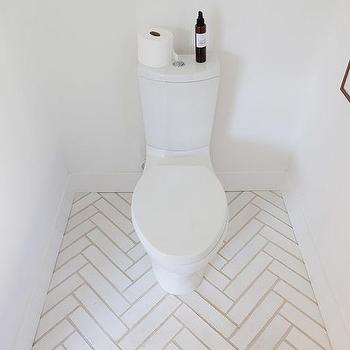 Modern Bathroom With White Herringbone Floors