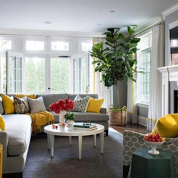 Gray Sectional With Yellow And Gray Pillows