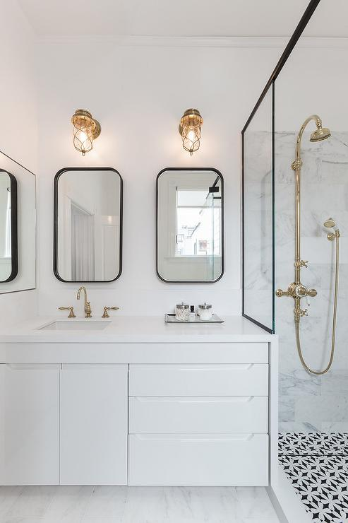 Modern Black And White Bathroom With Brass Cage Sconces
