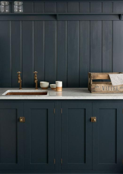 Navy shaker kitchen cabinets with navy beadboard for Dark blue kitchen cabinets