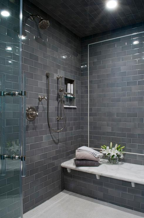 Gray subway shower tiles with white marble top bench contemporary