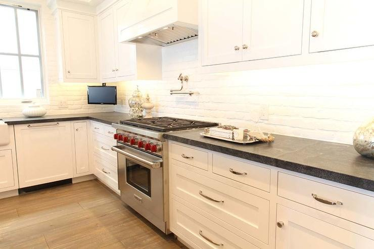 Charming White And Black Kitchen With White Exposed Brick Backsplash