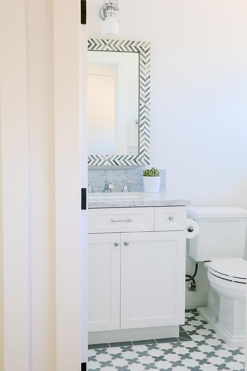 White and Gray Bathroom with Gray Herringbone Mirror