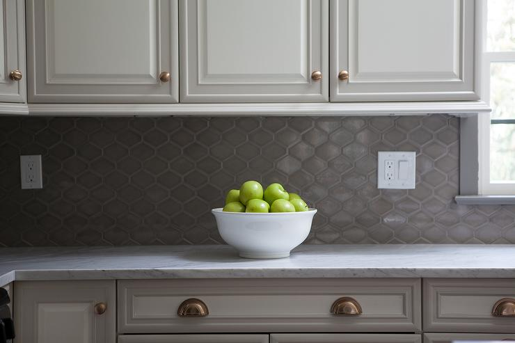 White raised panel kitchen cabinets with gray geometric for Backsplash for white cabinets and grey countertops