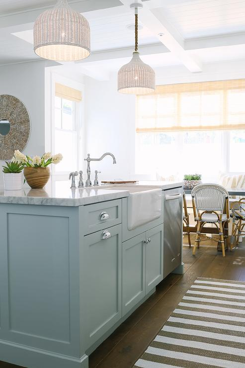 White Pendants Over Blue Center Island Transitional
