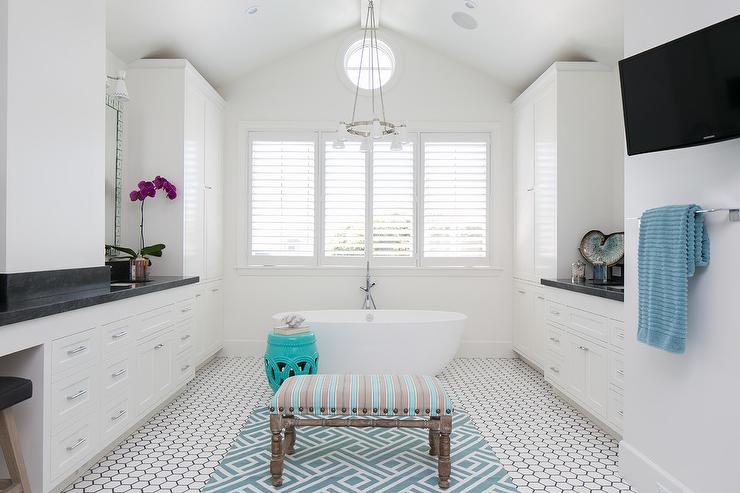 Black and white master bathroom with turquoise accents for Blue and black bathroom ideas