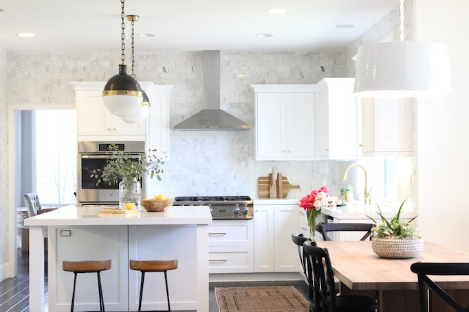 White Kitchen With Calacutta Marble Subway Tiles That Go