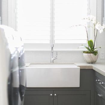 Gray Laundry Room With White Farmhouse Sink