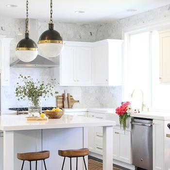 White Kitchen With Calacutta Marble Subway Tiles That Go