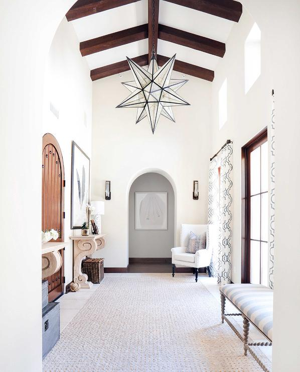 Long Foyer With Glass Moravian Star Pendants
