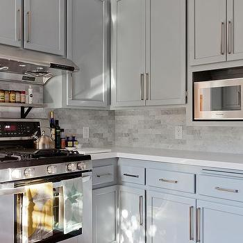 Gray Shaker KItchen Cabinets With Engineered White Quartz Countertops