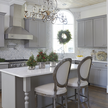 Gray Shaker Kitchen Cabinets with Marble Herringbone Tiles & Round Back French Counter Stools Design Ideas islam-shia.org