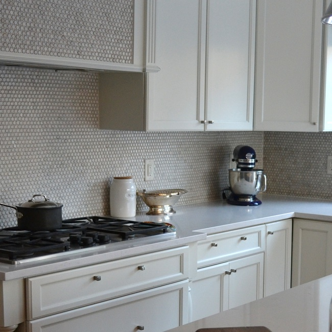 White Kitchen with Gray Penny Tile Backsplash