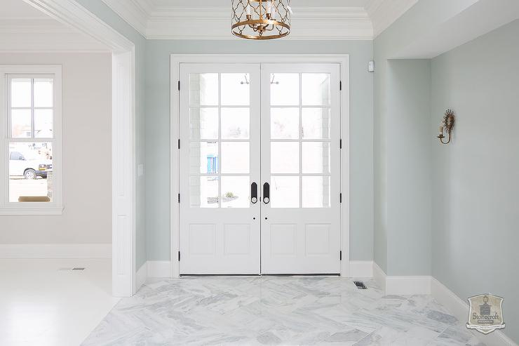 Blue foyer with marble herringbone floors transitional for Entrance foyer tiles