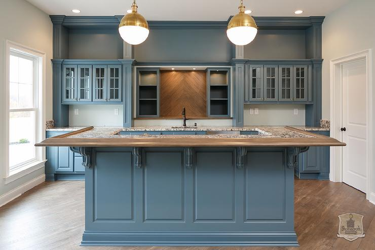 Contemporary Blue Kitchen Features Blue Raised Panel Cabinets Paired With  Granite Countertops.