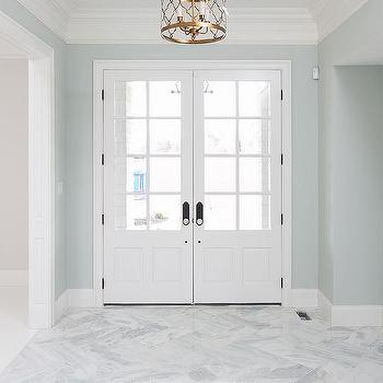 blue foyer with marble herringbone floors - Foyer Tile Design Ideas