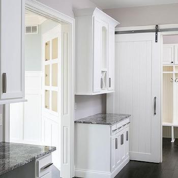 White Mudroom With White Shiplap Barn Door