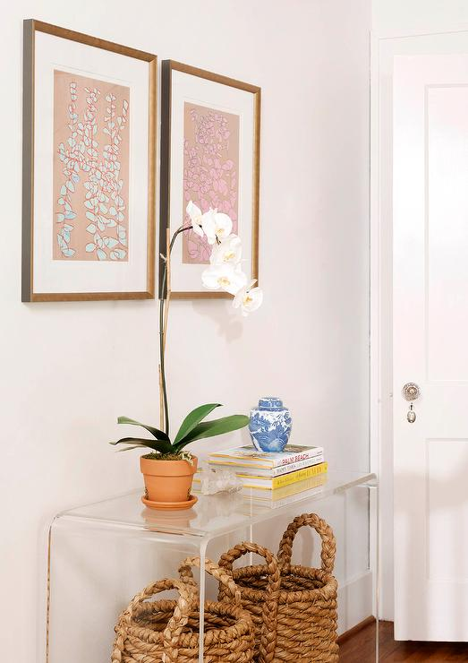 Bon Seagrass Baskets Tucked Under Clear Acrylic Console Table