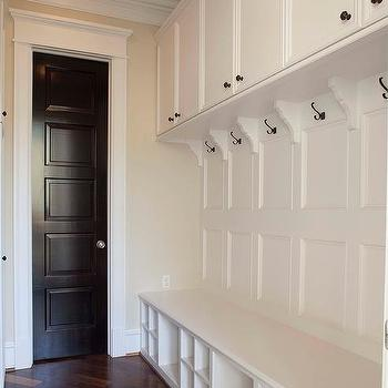 Mudroom With Paneled Walls And Shoe Cubbies