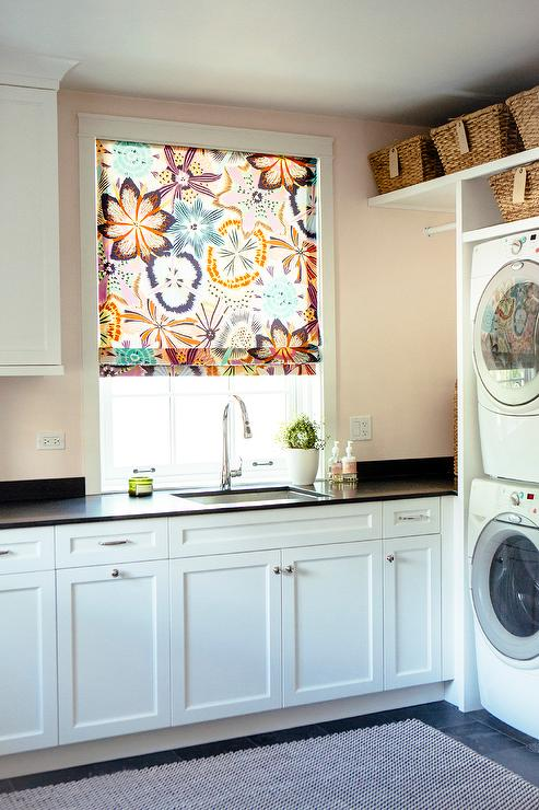 Pink Laundry Room Walls With Stacked Washer And Dryer