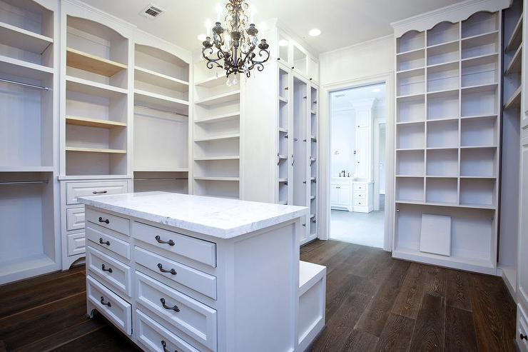 view full size. Chic white walk in closet features white ...