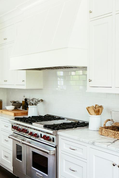 White Wood Kitchen Hood With Subway Tiles Transitional
