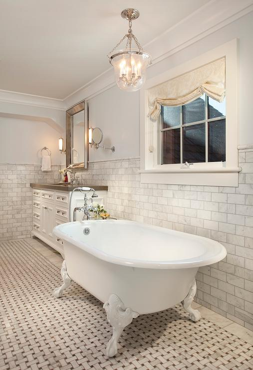 Elegant bathroom ideas traditional bathroom graciela for Claw foot soaker tub