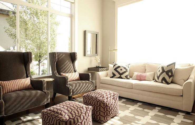 Chic Living Room Features A White Sofa Lined With Black And White Pillows  By Ikea As Well As A Pair Of Brown Wingback Chairs Lined With Pink Lumbar  Pillows ...