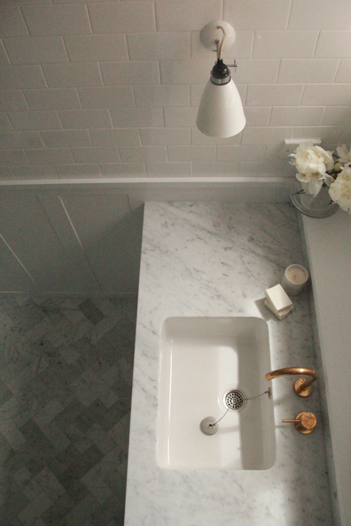 Modern Bathroom With Carrera Marble Herringbone Floor