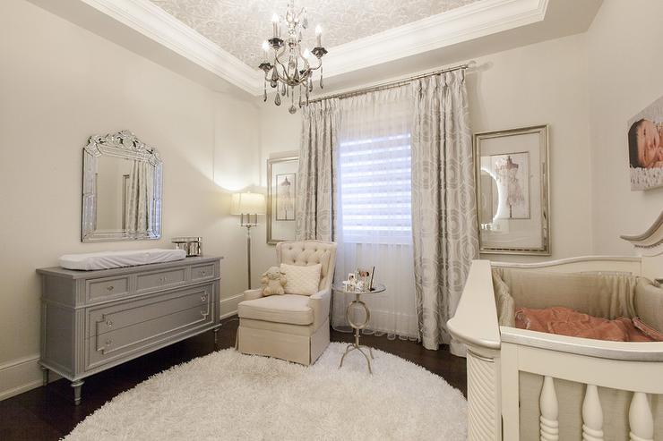 Elegant French Nursery With Gray Dresser And Changing Table
