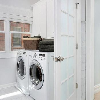 Frosted Glass Laundry Room Door With White Marble Floor
