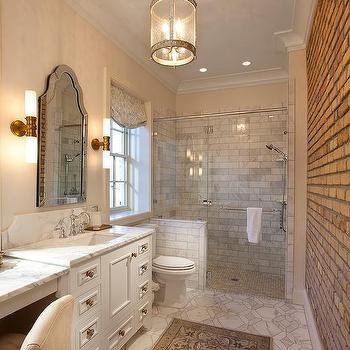 Long Bathroom With Exposed Brick Walls And Corsica Lantern