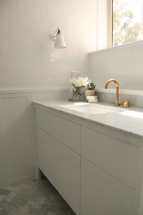 Bathroom with White Subway Tiles On Upper Walls and Board and ...