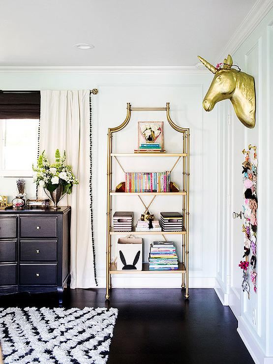 Kids Room With Gold Etagere And Gold Unicorn Head