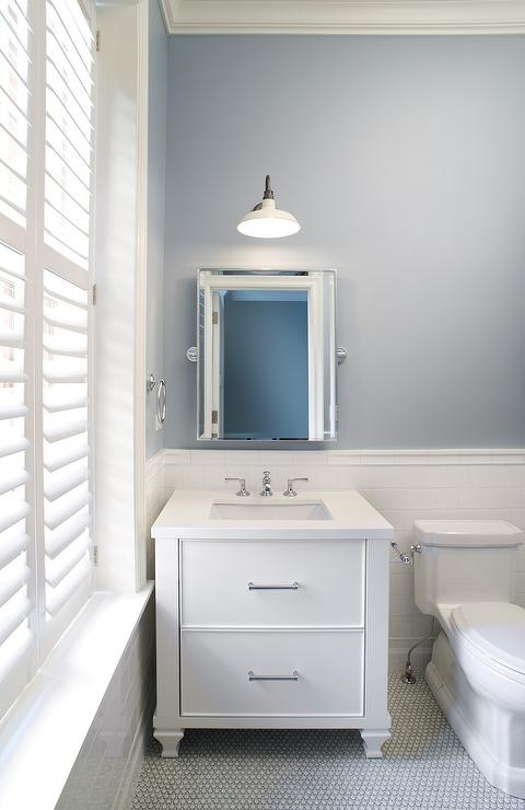 Contemporary white and blue bathroom features slate paint on upper walls  and white subway tiles on lower walls lined with a white washstand with  dresser. Slate Blue Bathroom Paint Design Ideas