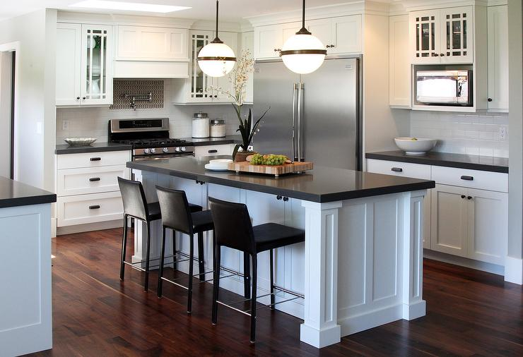 Black Kitchen Island With White And Gray Granite