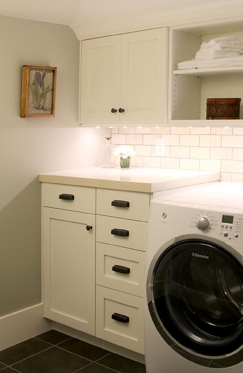 White Laundry Room Cabinets with Vintage Bronze Pulls ...
