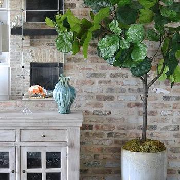 Exposed brick dining room walls design ideas for Distressed brick wall mural