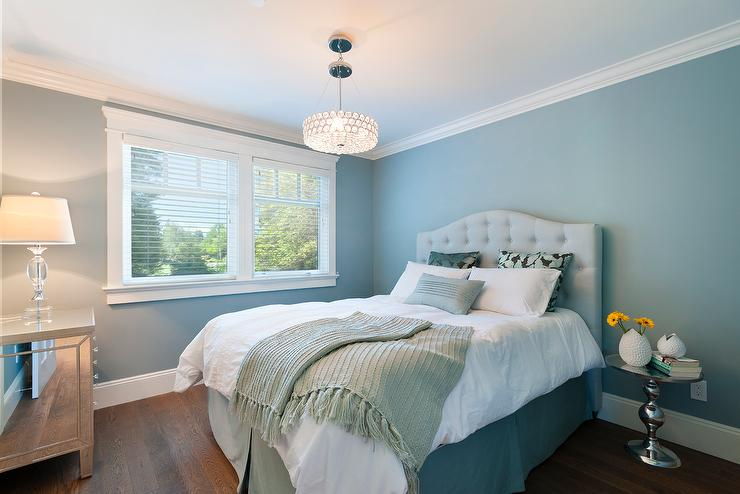 Blue bedroom features walls painted blue lined with a pale blue tufted  headboard on bed dressed in turquoise and black pillows as well as an ocean  blue. Light Blue Walls Design Ideas