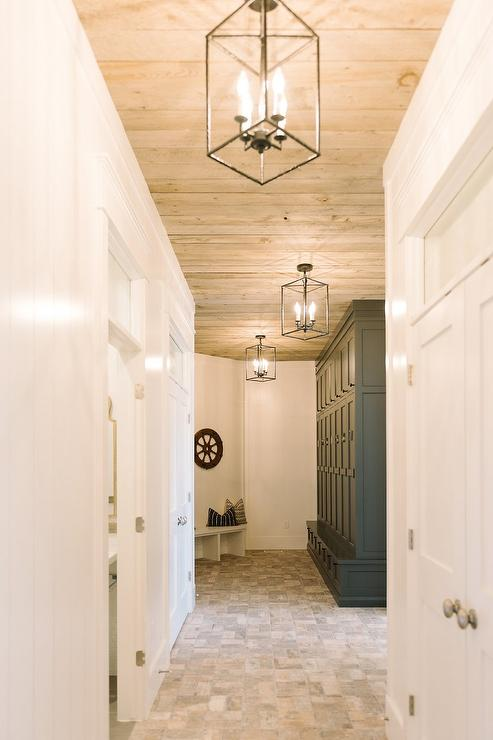 Long mudroom with curved bench and brick floor cottage for Mudroom floor