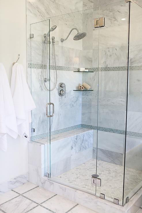 Lovely Bathroom Features A Corner Seamless Glass Shower Clad In Gray Marble  Tiles Accented With Gray Glass Mini Brick Tiles Lined With Stacked Corner  ...