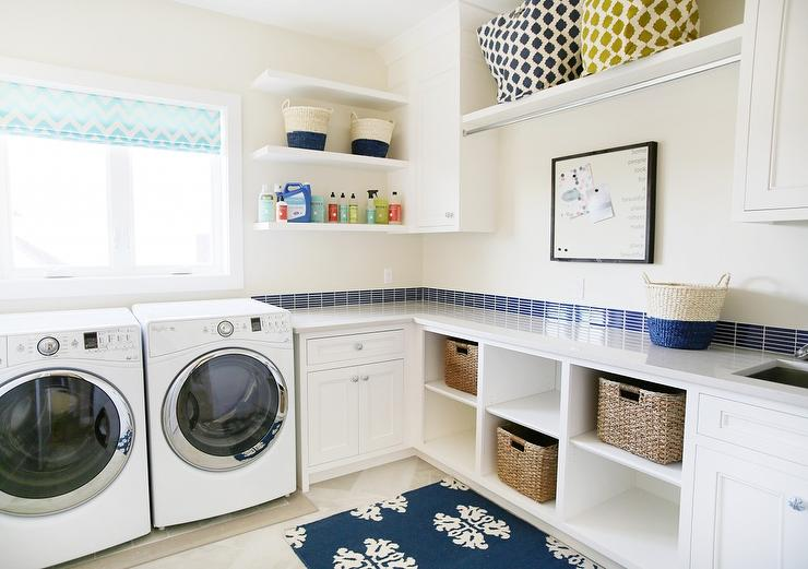 White And Blue Laundry Room With Cubbies Filled With