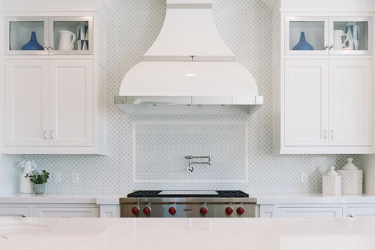 gray mosaic kitchen backsplash tiles with glass front cabinets