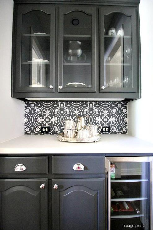White butler pantry with white herringbone tile backsplash for Black kitchen cabinets with glass doors