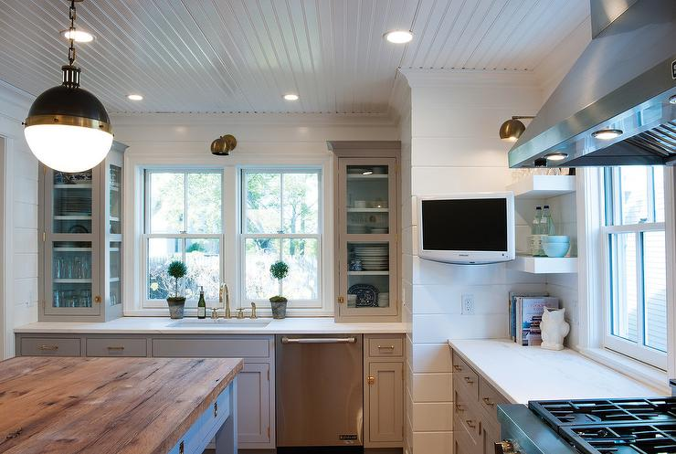 Hicks Pendants Hang Over A Freestanding Gray Kitchen Island Fitted With Drawers Adorned Unlacquered Brass Recessed Hardware Topped Butcher Block