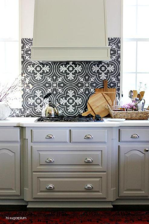 Black And White Mosaic Tile Kitchen Backsplash With Gray Kitchen Hood Transitional Kitchen