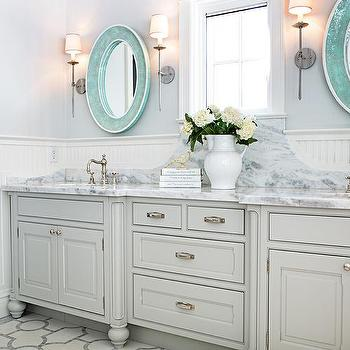 turquoise blue vanity with marble countertop and