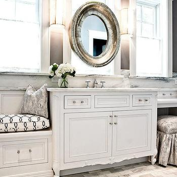 Bathroom Vanity In Front Of Window white and grey bathroom with silver oval vanity mirror in front of