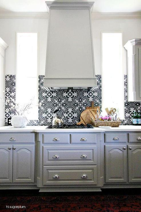gray kitchen cabinets with black and white backsplash transitional