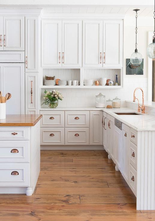White kitchen cabinets with copper cup pulls and copper for Kitchen cabinets hardware